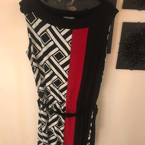 Black and white dress with a splash of red.